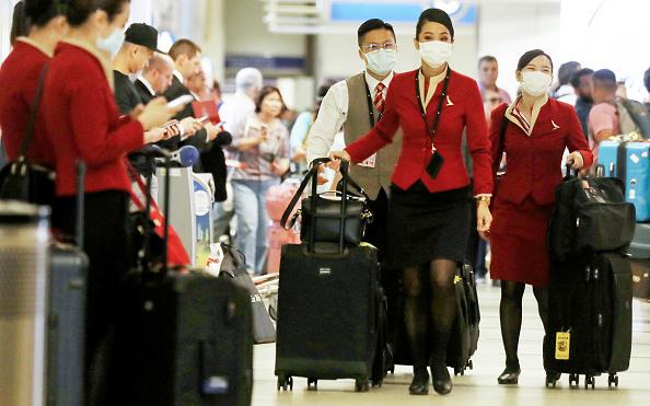 LAX Airport「Flight Crews Wear Protective Gear For International Flights」:写真・画像(13)[壁紙.com]