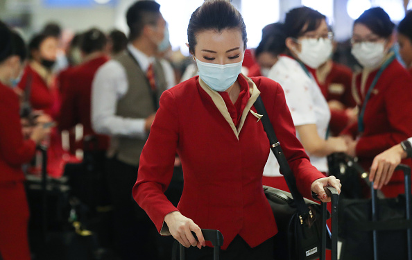 LAX Airport「Flight Crews Wear Protective Gear For International Flights」:写真・画像(9)[壁紙.com]
