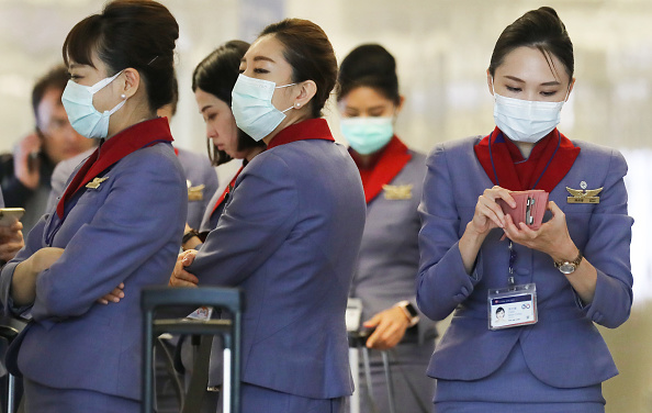 LAX Airport「Flight Crews Wear Protective Gear For International Flights」:写真・画像(10)[壁紙.com]