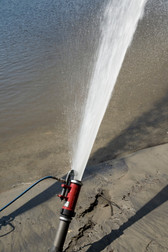 Hose「Hose from a fire truck spraying water into a river」:スマホ壁紙(16)