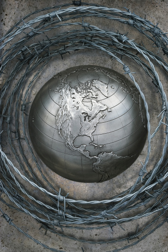 Surrounding「Barbed wire surrounding metal globe showing North America, close-up, overhead view」:スマホ壁紙(10)