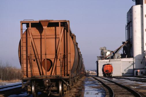 Factory「Wagon on railway beside factory, Saskatchewan, Canada」:スマホ壁紙(10)