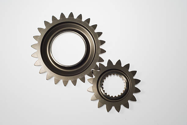 Two steel gears in mesh isolated:スマホ壁紙(壁紙.com)