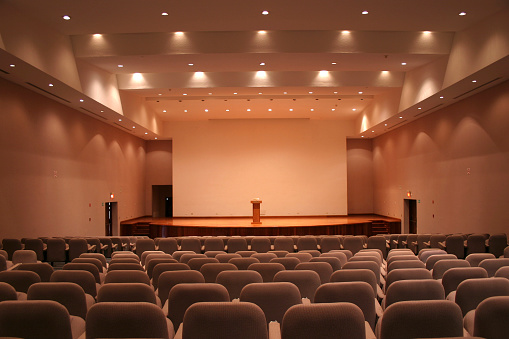 Meeting「Empty auditorium with grey seats and downlights」:スマホ壁紙(0)