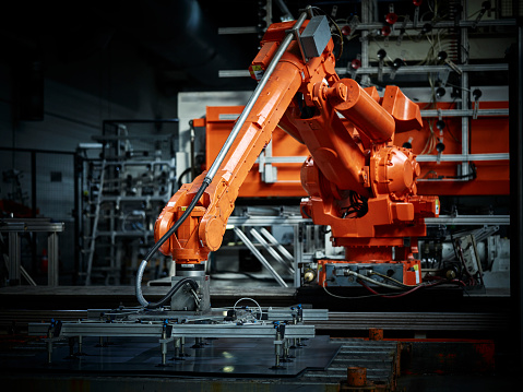 Metal Industry「Industrial robot arm used in metalworking」:スマホ壁紙(1)