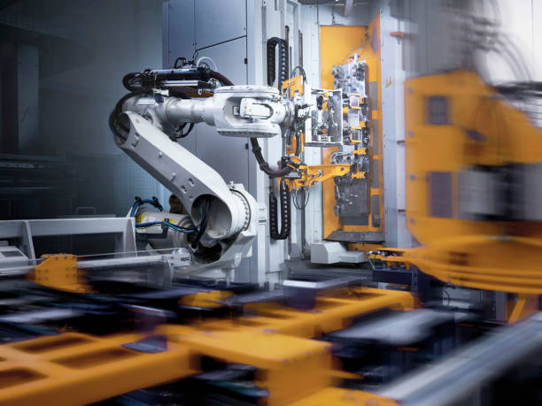 Industrial robot in modern factory:スマホ壁紙(壁紙.com)