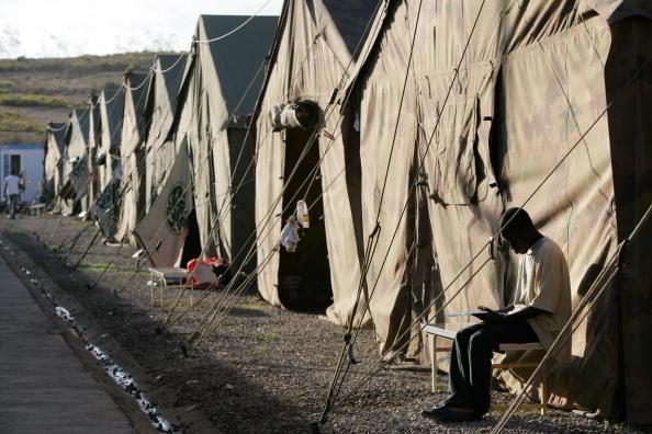 Marco Di Lauro「African Migrants Seek Refuge In Temporary Shelter」:写真・画像(12)[壁紙.com]
