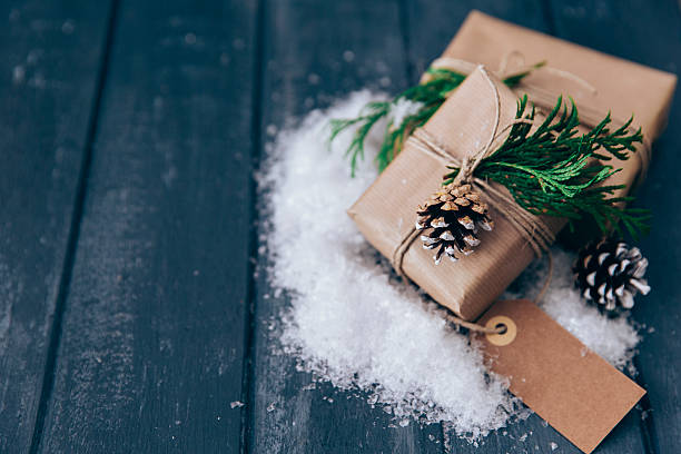 Wrapped Christmas gifts with pine cone, fir and fake snow decoration:スマホ壁紙(壁紙.com)