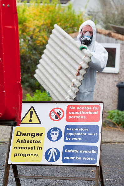 Absence「A specialist asbestos removal company removing asbestos from a shed roof of a house in Ambleside, Cumbria, UK.」:写真・画像(6)[壁紙.com]