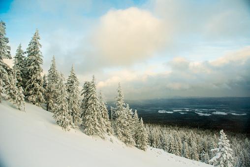 Steep「Snowy hillside over remote landscape」:スマホ壁紙(8)