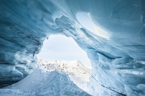 Ice Climbing「View out of a glacier cave in the mountains」:スマホ壁紙(2)