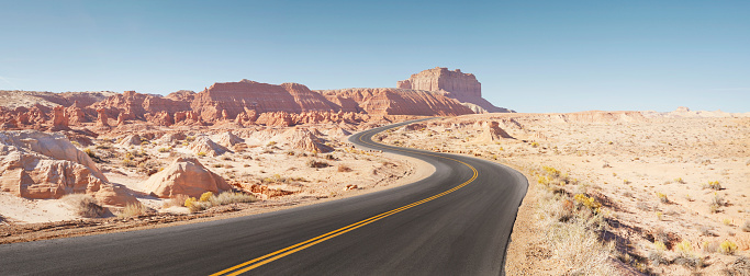 Utah「Winding empty road through arid desert landscape panoramic」:スマホ壁紙(14)
