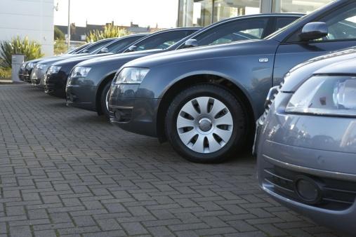 Car Dealership「Row of metallic blue cars in car dealer's car park」:スマホ壁紙(9)