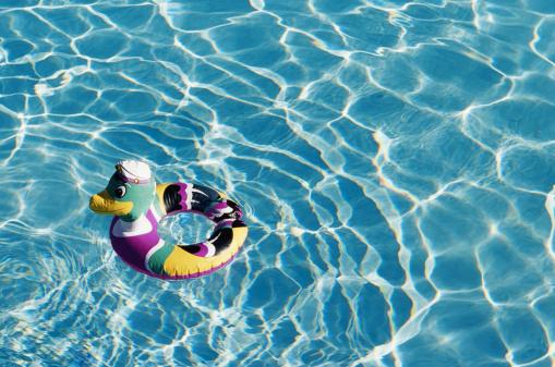 プール「Duck shaped inner tube floating in pool」:スマホ壁紙(6)