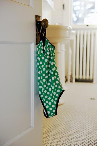 水着「Girl's swimsuit hanging on vintage door knob」:スマホ壁紙(18)