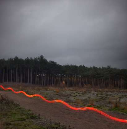 Light Trail「Red light trail on path in countryside.」:スマホ壁紙(16)
