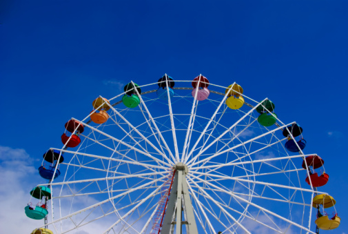 Passenger Cabin「Low angle image of a Ferris wheel against a blue sky」:スマホ壁紙(9)