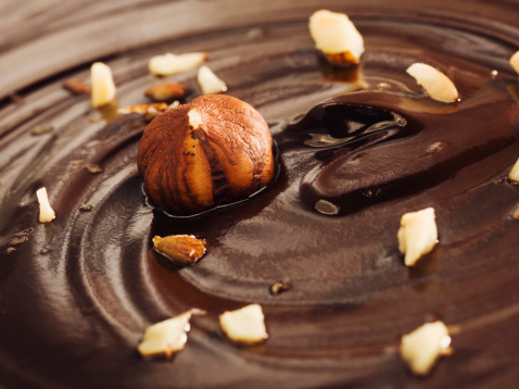 Nut - Food「Chocolate surface with swirl and hazelnut, close up」:スマホ壁紙(16)