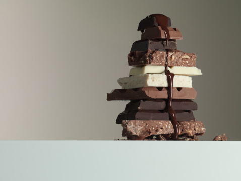 Milk Chocolate「Chocolate syrup dripping over stack of chocolate bars」:スマホ壁紙(2)
