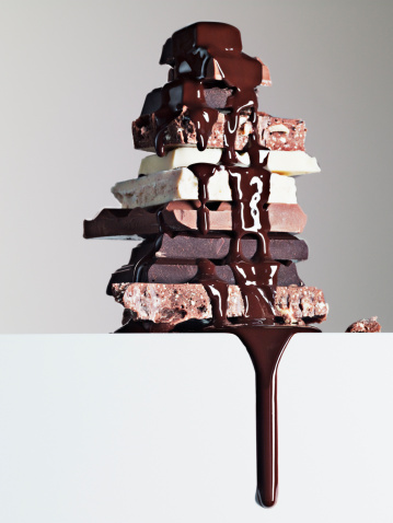 Excess「Chocolate syrup dripping over stack of chocolate bars」:スマホ壁紙(16)