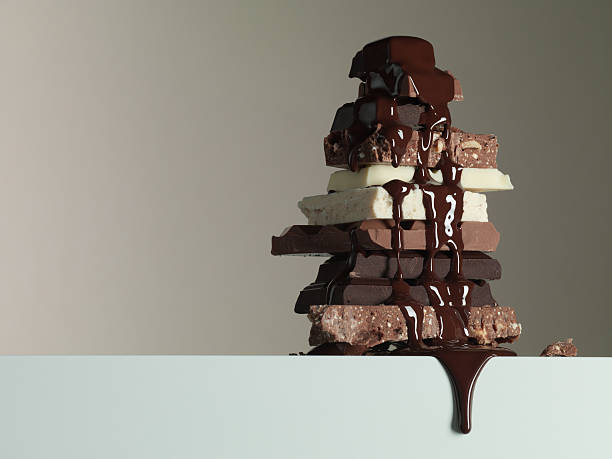 Chocolate syrup dripping over stack of chocolate bars:スマホ壁紙(壁紙.com)