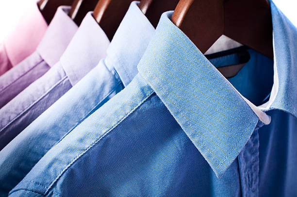 Blue and pink elegant button down shirts hanging on hangers:スマホ壁紙(壁紙.com)