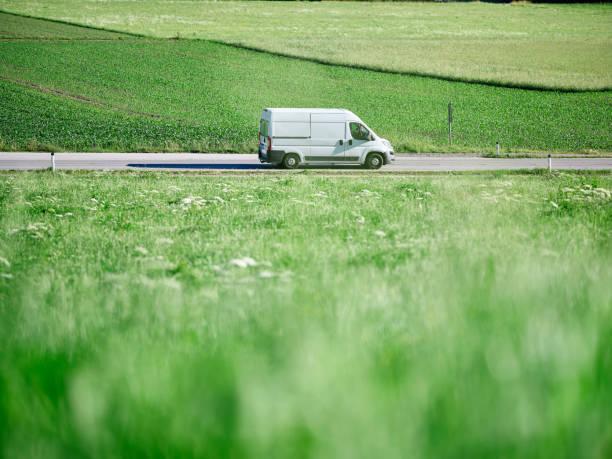 Delivery Van moving on highway along green field:スマホ壁紙(壁紙.com)