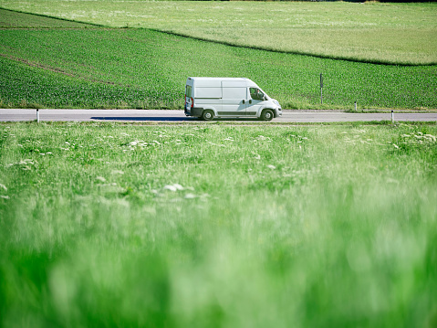 Focus On Background「Delivery Van moving on highway along green field」:スマホ壁紙(0)