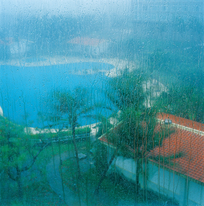Northern Mariana Islands「high angle view of rain scenic from glass window,palm tree and swimming pool」:スマホ壁紙(11)