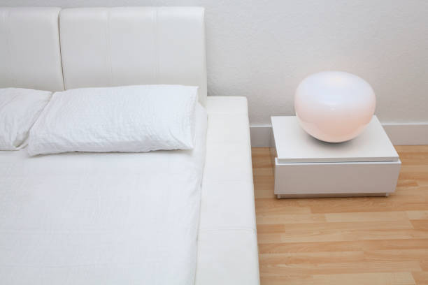 High angle view of bed and night table in modern bedroom:スマホ壁紙(壁紙.com)
