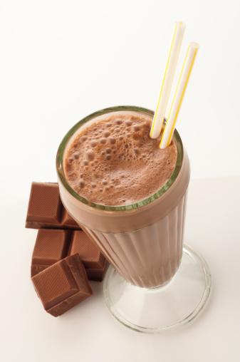 Milk Chocolate「High angle view of chocolate milkshake glass on white backdrop」:スマホ壁紙(15)