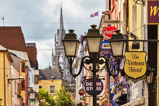 County Cork「Signs and lights in a street scene in downtown Cork, with Holy Trinity Church in the background, Ireland.」:スマホ壁紙(15)