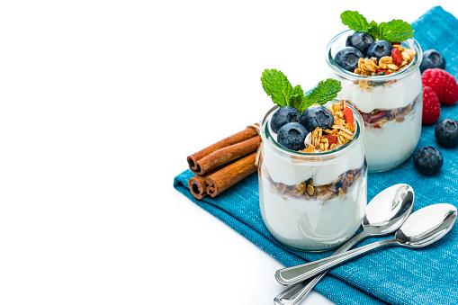 Yogurt Container「Yogurt with granola and berries on white background.」:スマホ壁紙(12)