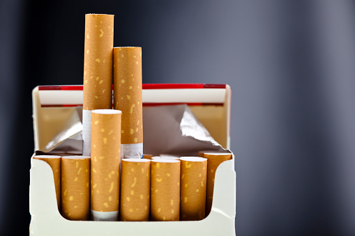 Cigarette「An up close view of a package of several cigarettes 」:スマホ壁紙(0)