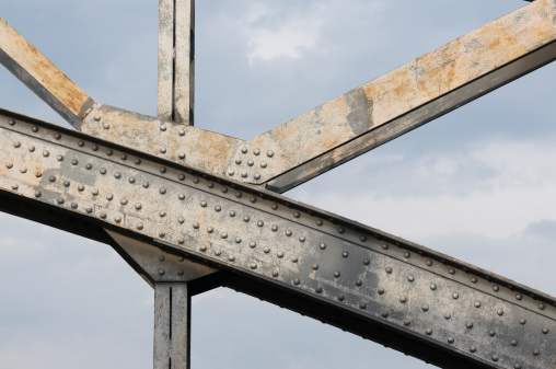 Steel「An up close image of the beams holding up a steel bridge」:スマホ壁紙(4)