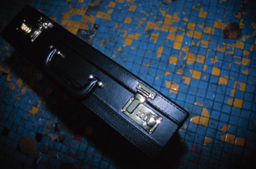 Briefcase「Attache case on tile floor of public area at night」:スマホ壁紙(15)