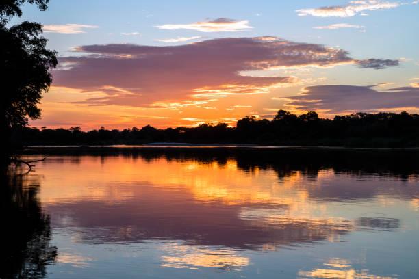 Sunset over Cubango River, Namibia, Africa:スマホ壁紙(壁紙.com)