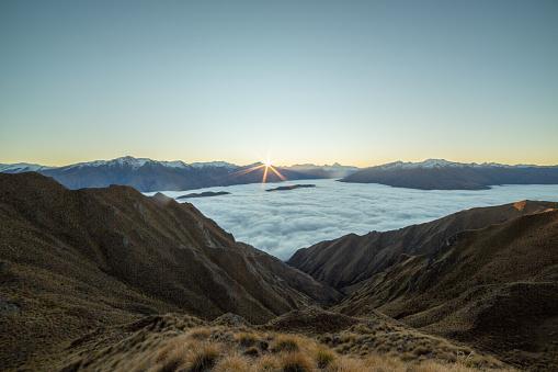 Mt Aspiring「Sunset over the clouds, mountain landscape」:スマホ壁紙(8)