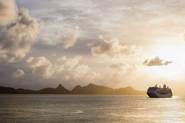 Sunset over the sea with a cruise ship in Grenadines:スマホ壁紙(壁紙.com)