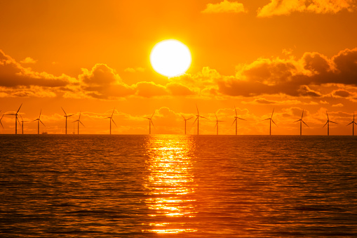 Wind Turbine「Sunset over the Walney offshore Wind farm from Walney island  The windfarm will shortly be the largest offshore wind farm in the world and currently generates 367 MW.」:スマホ壁紙(0)