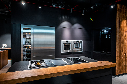 Furniture Store「A Bauhaus, contemporary kitchen layout design with predominantly dark and sterile look」:スマホ壁紙(13)