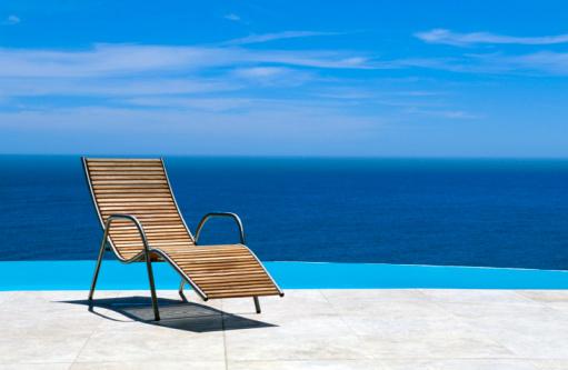 Deck Chair「Poolside lounge chair overlooking ocean」:スマホ壁紙(4)