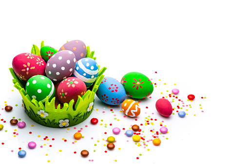 Easter Basket「Colorful Easter eggs with candies and sugar sprinkles isolated on white background. Copy space」:スマホ壁紙(11)