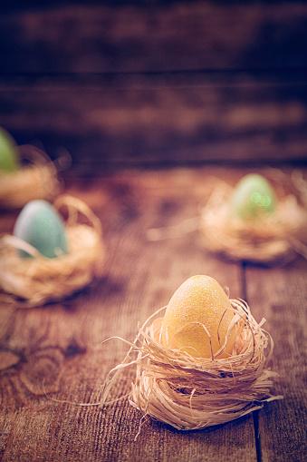 イースター「Colorful Easter Eggs Decorated on Wooden Background」:スマホ壁紙(6)