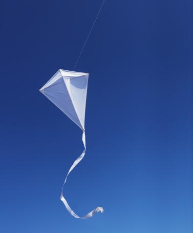 Kite - Toy「White kite against blue sky.」:スマホ壁紙(13)