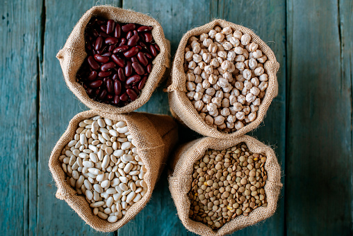 Bean「Four sacks of dried brown lentils, chickpeas and red and white beans on wood」:スマホ壁紙(1)