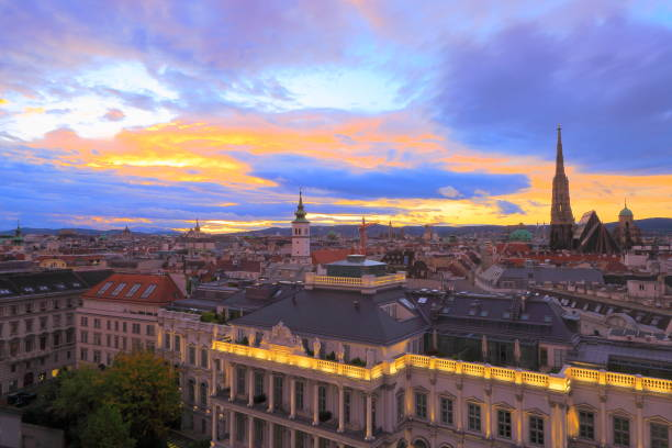Above Beautiful Vienna Cityscape panorama, with St. Stephen's Cathedral, impressive building architecture and urban skyline at dramatic sunset – Vienna , Austria:スマホ壁紙(壁紙.com)