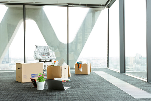 Moving Office「Cardboard boxes on empty office floor」:スマホ壁紙(4)