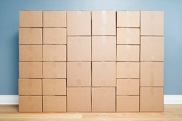 Cardboard boxes stacked one on another:スマホ壁紙(壁紙.com)