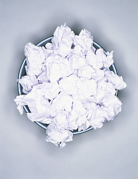 Crumpled paper in wastepaper bin, view from above:スマホ壁紙(壁紙.com)